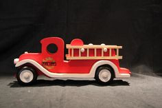Old style fire engine with removable ladders. made of wood, toys, fun for children.fire truck,wood toy, wooden toy,push pull,