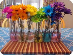 I love doing this with flowers! You put food coloring in the water and the stem of the flower soaks it up and changes the color of the flower. ~T