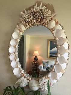 Shell Mirrors - Seashore Chic... note placement of scallops. They add both depth and airiness to the design.