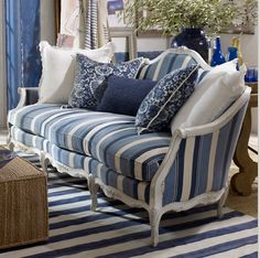 love the bold blue and white stripes on the traditional...French sofa...not to mention the blue and white print pillow...