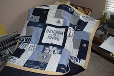 quilt out of all the old T-shirts her husband wore when they dated at BYU. T Shirt Reconstruction, Teaching Patterns, Gifts For Hubby, Purple Quilts, Old T Shirts, Tee Shirts, Quilt Making, Sewing Projects, Yarn Projects