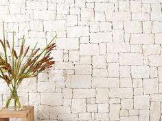 Newport random ashlar stone limestone walling. Possible stone cladding for fire place