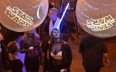 """Storm troopers, jedi knights and Death Star guards were among the characters sipping cocktails Wednesday night in downtown Macon to celebrate Thursday's premiere of the new Star Wars movie, """"The Force Awakens.""""  Read more here: http://www.macon.com/news/local/article50175515.html#storylink=cpy"""