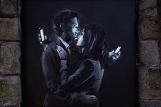 "Banksy's new mural features ""mobile lovers"""