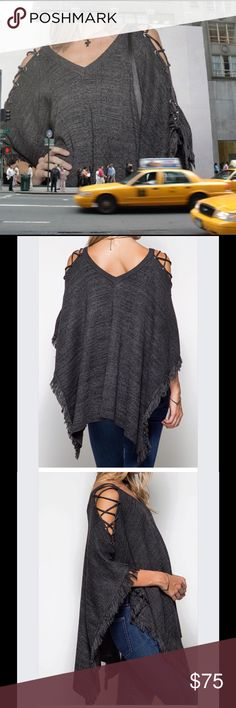 Criss cross lace-up sleeve fringe poncho BOHO CHIC Stunning poncho. Criss cross lace up sleeves  V neck in front and back. This is a head turner! Sweaters Shrugs & Ponchos