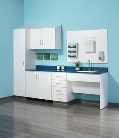 """New exam room casework. """"Folio"""" Nurture by Steelcase in """"arctic white"""" with """"linen"""" laminate countertop."""