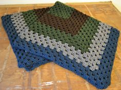 Brown, Green, Grey and Navy Medium Square Afghan by aniemandesign on Etsy Afghan Blanket, Blanket Cover, Blue Brown, Green And Grey, Rustic Lodge Decor, Flower Crafts, Home Accents, Etsy Shop, Navy