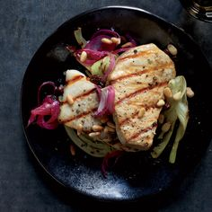A riff on the classic Venetian dish sarde in saor, this recipe combines meaty swordfish with vinegared onions and smoky grilled fennel.