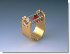 I love this stainless steel and ruby ball ring. Seriously unusual jewelry design. - Jessie