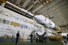 The escape tower, Soyuz TMA-14 spacecraft and third stage are moved for assembly to the first and second stages Monday, March 23, 2009 at the Baikonur Cosmodrome in Kazakhstan. The Soyuz is scheduled to launch the crew of Expedition 19 and a spaceflight participant on March 26, 2009.