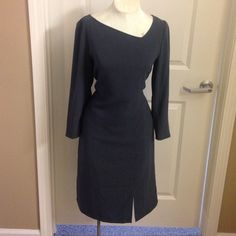 Joan Rivers dark gray business dress The dress was pinned in the back for the picture. Fits like a shift dress. Zipper down the back Joan Rivers Dresses Long Sleeve