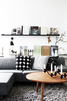 book display + floating shelf in neutral scandi-inspired living room design