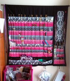 knitting needle hanging organizer  I definitely need something like this. I have way too many needles for just a case.