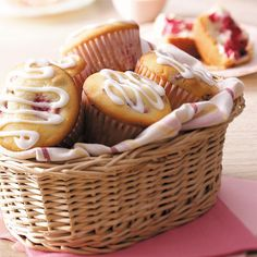 Cream Cheese Raspberry Muffins Recipe - Everyone loves these moist, cake-like muffins flavored with raspberries and walnuts. The sweet drizzle of icing makes them pretty enough to serve guests. —Phyllis Schmalz, Kansas City, Kansas