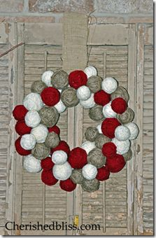 Really cute DIY yarn ball wreath from Cherished Bliss. You could add any kind of embellishments to this to dress it up. Bows, greenery or stuffed figurines like reindeer would be adorable but the wreath looks great on it's own too.