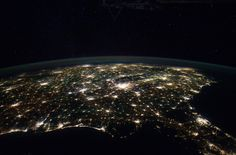 This astronaut photograph from the International Space Station highlights the southeastern part of the Southern United States at night, including the eastern Gulf of Mexico and lower Atlantic Seaboard states. The brightly lit metropolitan areas of Atlanta, Georgia (image center) and Jacksonville, Florida (image lower right) appear largest in the image with numerous other urban areas forming an interconnected network of light across the region. A large dark region to the northwest of…