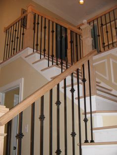 Double Knuckle, Single Knuckle, and Plain wrought iron balusters in Satin Black