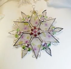 Stained Glass Star. Holiday ornament. Suncatcher. Snowflake. Christmas Violet Flower Star.