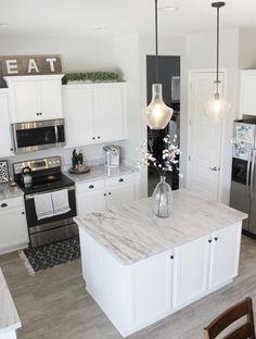 Modern Farmhouse Kitchen Decor. Sherwin Williams Repose Gray paint color.