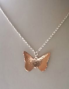 A copper butterfly pendant with a polished and hammered finish Butterfly Pendant, I Got This, Workshop, Copper, Necklaces, It Is Finished, Silver, Blog, Handmade