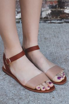 When spur of the moment weekend adventures pop up just go with the flow and throw on our Laid Back Sandals for the optimal touch to your outfit. They are a pair of faux leather, flat sandals. They feature an ankle strap and contrasting toe strap.
