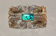 This Shane Henderson-designed Stetson belt buckle is handcrafted and is quite a beauty.