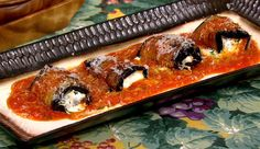 Carla and Clinton's Eggplant Rollatini>>>>ingredients  2 Eggplants (sliced lengthwise into 1/4-inch-thick pieces)1/2 cup Olive Oil1 cups Ricotta1/2 cup Basil (chiffonade)2 cloves Garlic (minced)3 sprigs Thyme (leaves only - chopped)Zest of 1 LemonSalt and Freshly Ground Pepper1/4 cup Parmigiano Reggiano plus extra to garnish2 cups Tomato Sauce1 egg1/2 cup mozzarella (shredded)