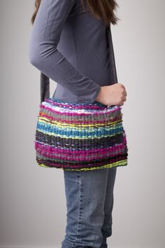 """This colorful handmade bag was made using the Loopdeloom weaving loom. In addition to making scarves, bags, and cell phone cases, the Loopdeloom can be used to make large scale pieces, too! You can weave items any length, and up to 7"""" wide using one loom. Connect two or more looms together to weave wider items with no seams – genius! Say goodbye to traditional looms, we're putting a new spin on weaving!"""