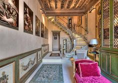 This luxury Italian penthouse in the heart of Rome features an extraordinary staircase that connects the master suite with the rest of the apartment.