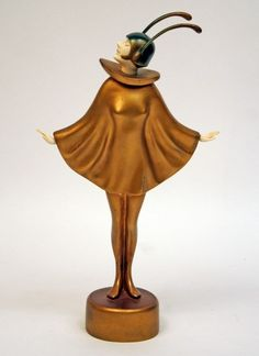 A cold patinated bronze and ivory sculpture by ROLAND PARIS depicting a Girl with Antennas. Made in Germany circa 1930. Signature: Roland Paris, Berlin Foundry Stamp. H. 12 in. (hva)