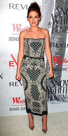 Kristen Stewart opts for a patterned hunter green bustier with an ankle-length skirt, plus sparkly pumps (all by Balmain), at the Sydney premiere of Snow White and the Huntsman.