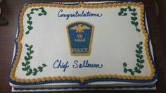Cake with hand piped badge to honor swearing in of new Police Chief of Seven Hills.