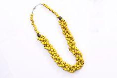 Colar Trançado Açaí Amarelo #acessorios #colar #biojoia #biojewels #amarelo #eco http://www.elo7.com.br/colar-trancado-acai-amarelo/dp/4DAF1A