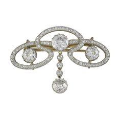 An Edwardian diamond scroll brooch