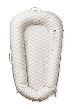 DockATot™ Deluxe Dock - Silver Lining Chevron cover is a stylish baby lounger new moms can't live without.