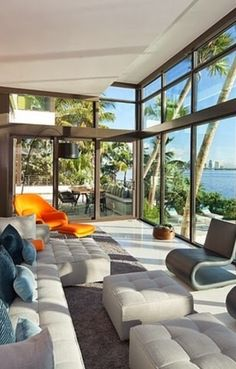 Coral Gables Residence is located on waterfront site with views of Biscayne Bay to downtown Miami, Florida. Designed by Touzet Studio