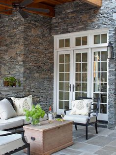 . To provide illumination the homeowners instead rely on a transitionally styled lantern-influenced sconce./