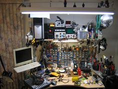 My workbench. An IKEA jerker desk with some modifications. Computer Repair Shop, Electronic Workbench, Workshop Studio, Diy Workbench, Mirror Ball, Ikea Hackers, Contemporary Office, Shop Layout, Shelf Brackets