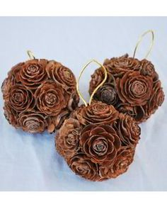Could make these our of pinecone roses with Holiday bow on top - Mini Pine Cone