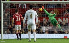 Manchester United's Spanish goalkeeper David de Gea (R) fails to save Swansea City's Icelandic midfielder Gylfi Sigurdsson goal during the English Premier League football match between Manchester United and Swansea City at Old Trafford in Manchester, north west England, on January 2, 2016. Manchester United won the game 2-1. AFP PHOTO / OLI SCARFF No use with unauthorized audio, video, data, fixture lists, club/league logos or 'live' services. Online in-match use limited to 75 images, no…