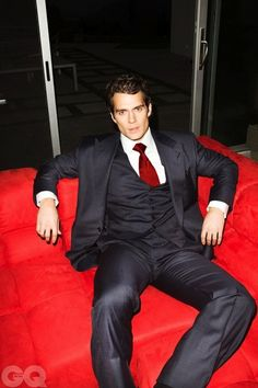 Henri Cavill for GQ...Red tie highlights a dark grey suit, men's style