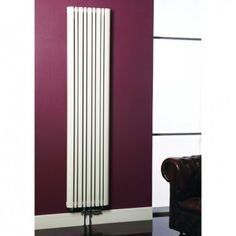 Tall tower radiator, high on plum background with european double straight valve