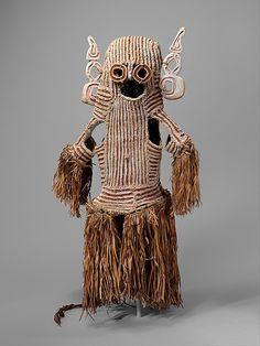Body Mask (Det)    Date:      mid-20th century  Geography:      Indonesia, Papua Province (Irian Jaya), Ambisu village, Ajip River  Culture:      Asmat people  Medium:      Fiber, sago palm leaves, wood, paint