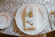 Vintage table setting for our wedding using mix and match vintage handkerchiefs. Frank and Kristen - September 22, 2013 Sunstone Villa and Winery in Santa Ynez, Ca. Photos taken by Erin Leigh @ thebowerygirl.com.