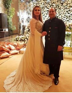 The adorable couple Mr. Rahat Fateh Ali Khan pose for a photo at the birthday of their son in Lahore. Shadi Dresses, Pakistani Dresses, Girls Dresses, Flower Girl Dresses, Formal Dresses, Rahat Fateh Ali Khan, Pakistani Actress, Bridesmaid Dresses, Wedding Dresses