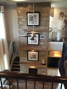 Tyler Morrison Steiner Ranch two story stone fireplace with three mantels