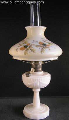 """Aladdin manufactured """"Tall Lincoln Drape"""" oil lamps in a range of colours from 1940-1949. This alacite version does not glow under UV light so we know it was produced after 1942."""