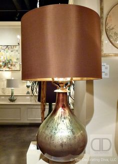 Stunning lamp with metallic painted glass base & shimmering  copper shade convey timeless elegance. Spotted at the John-Richard furniture and décor showroom at the fall 2013 High Point Market.  John Richard Table Lamp Copper Shade and Glass Base | The Decorating Diva, LLC  #HPMKT