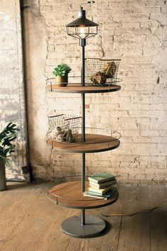Kalalou Three Tier Display Floor Lamp - The three wood slatted round shelves, each with a metal rail for design as well as function, are spaced along an iron pole topped with a street-light styled fixture.