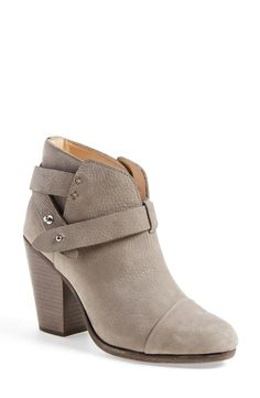 These classic grey booties are a stable! Absolutely loving the pushpin hardware that holds the leather strap around the ankle for a modern chic look.